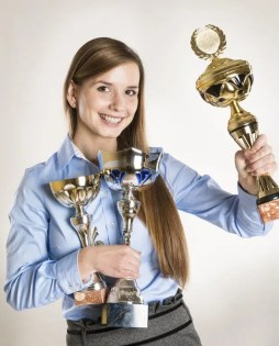 student with trophies