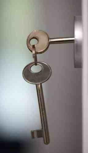 old fashioned keys in a lock