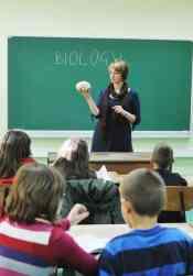 Teacher in biology class