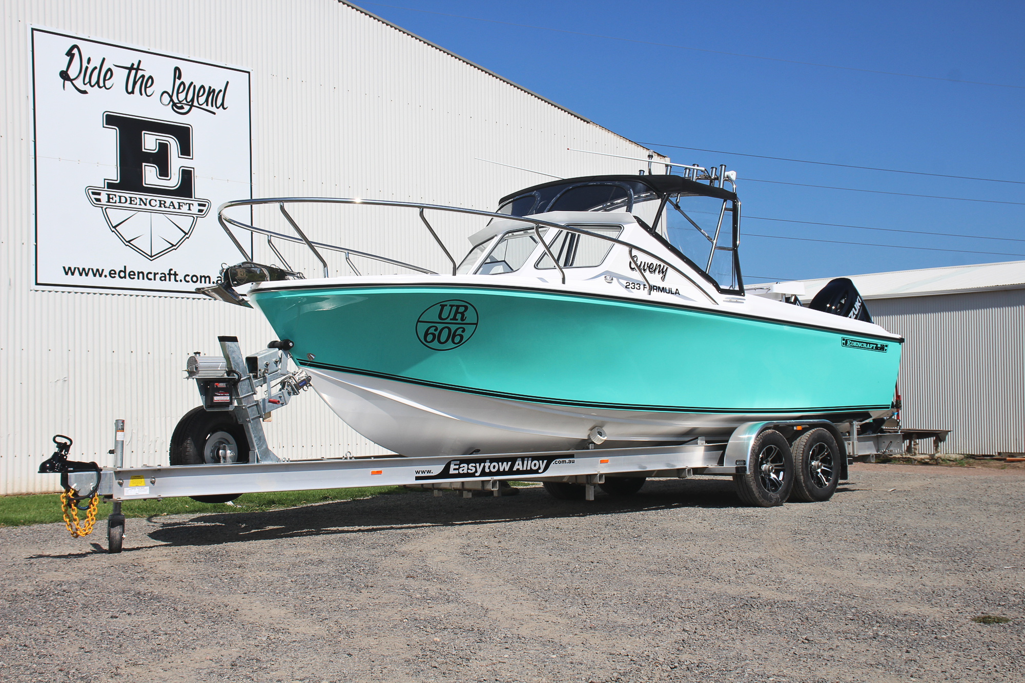 Edencraft 233 Formula Classic with turquoise colour sides and black decals sitting on EasyTow trailer