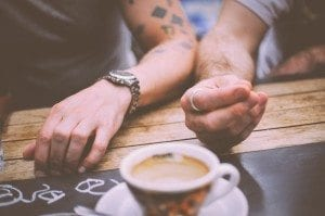 two men hands with coffee