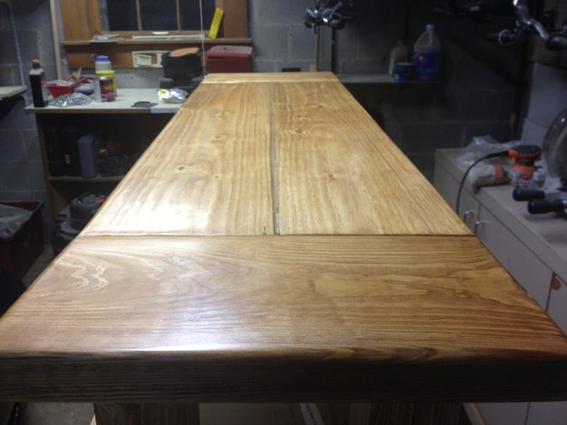 Closeup of the bench after staining and coating with polyurethane