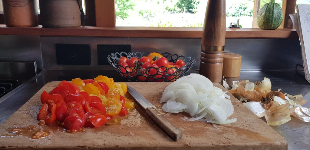 prepping tomatoes and onions for pie