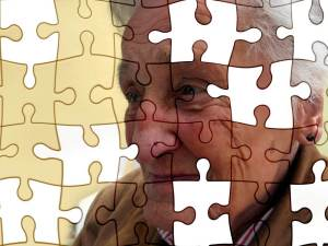 Elderly woman with puzzle pieces overlay