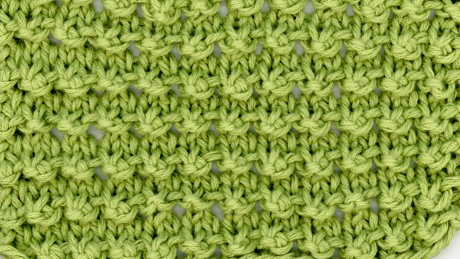 green textured knitting stitch pattern