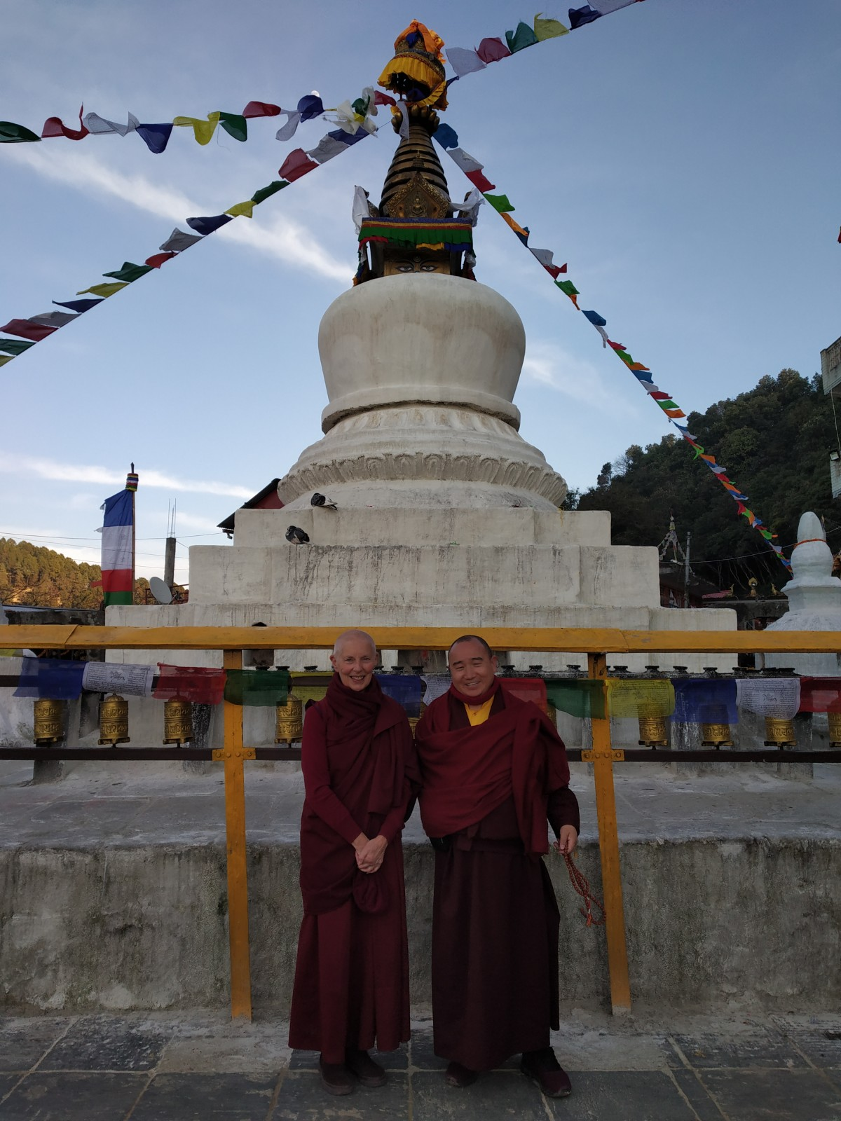 Ani Rinchen with Tulku Damcho at the Choten on the holy site, where the Bodhisattva who became the Buddha, fed his body to the starving tigress and her cubs