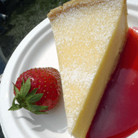 Lemon tart with fresh strawberries.