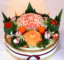 Carved fruit and veg makes your table settings pop.