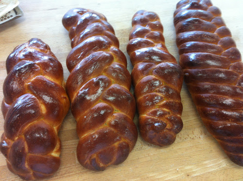 Braided or plaited challah: challah bread braided with different numbers of strands. I wish I could say I did the six strand, far right, but I did not. Mine are the four (left most) and five stranded versions.