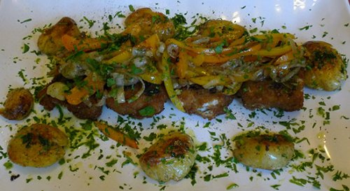 Veggie bacalao: crispy fillets with sweet onions and peppers, served with potatoes. KEi's Veggie Kitchen