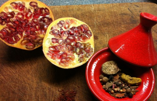 Pomegranates and a selection of the spices in the ras-el-hanout spice mix