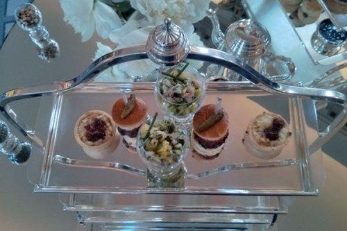 Mini burgers, wonderful cheese tarts and prawn cocktail on glittering silverware. Colonnades, Edinburgh