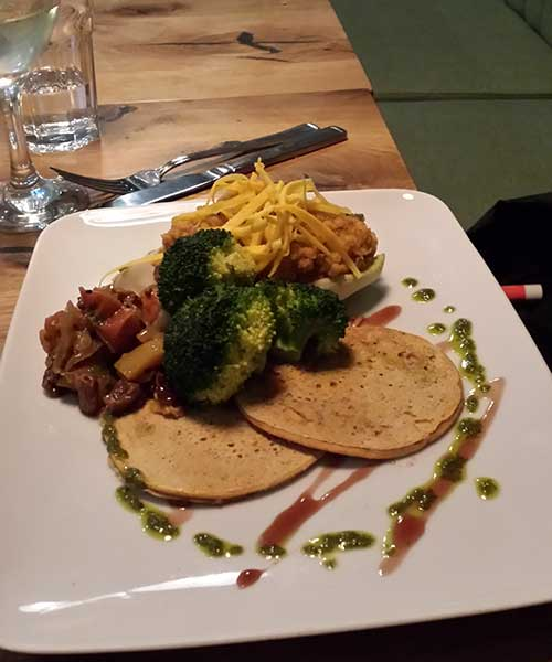 Chickpea pancakes with apricot pate and crisp veg.