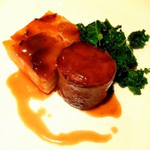 Braised Borders shoulder of lamb, pressed potato and turnip, sautéed kale