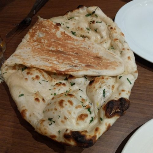Fluffy garlic naan at Passage to India