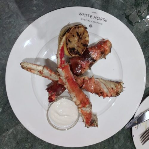 King crab legs, charred from the grill and oh! so good.