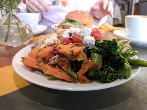 Crrrunchy greens and sweet potato salads (the other are hiding) topped with feta. So good!