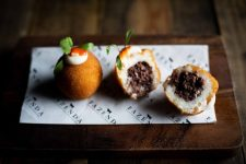 Coxinha - Delicious fried potato is stuffed with black pudding, and is topped with a spicy sriracha sauce