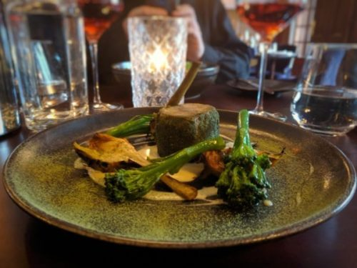 Lamb shoulder with black truffle espuma, broccoli and artichokes.