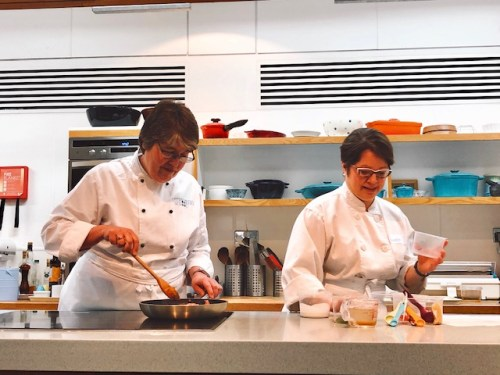 The experts teach the assembled group of eager foodies how to cook a Penaeng Curry