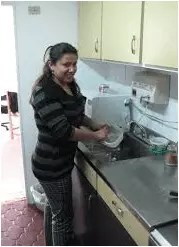 maid cleaning kitchen