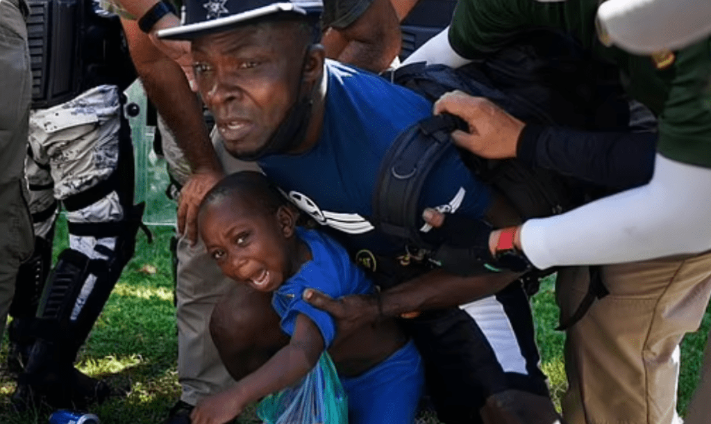 A Haitian migrant and his son are detained by Mexican security forces.