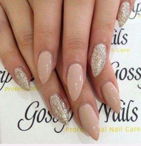 almond nude glitter manicure