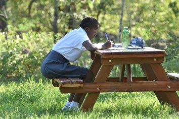 Student on outdoor study benches