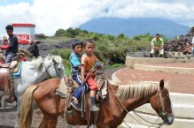Cute kids on horse at volcano