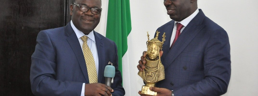 President, Edo College Old Boys Association (ECOBA), Dr. Reuben Osahon (left), presenting a gift to the Edo State Governor, Godwin Obaseki, during a courtesy visit by the association to the Government House, Benin City on Monday, November 6, 2017.
