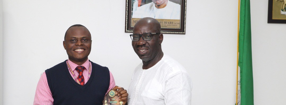 L-R: 1st Prize Winner in the Nigerian Content Development and Monitoring Board (NCDMB) Annual Oil & Gas Undergraduate Essay Competition, Mr. Osamede Ikponmwosa Kingsley, presents his prize to Edo State Governor, Mr. Godwin Obaseki, during a courtesy visit to the governor, at the Government House, Benin City, on Friday, December 15, 2017.