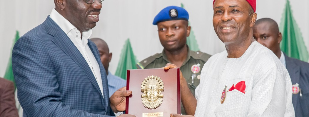 Edo State Governor, Mr. Godwin Obaseki (left) presenting a plaque to the Minister of Science and Technology, Dr. Ogbonnaya Onu, during the 15th Annual Meeting of the National Council of Science and Technology (NCST) in Benin City, Edo State capital.