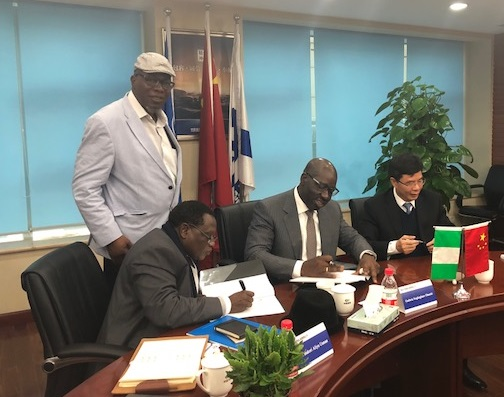 L-R: Nigerian Ambassador to China, Amb. Usman Bakori; Chairman, Edo State Strategic Planning Team, Prof. Julius Ihonvbere (standing); Edo State Governor, Godwin Obaseki; Chairman, China Harbour Engineering Company (CHEC) Ltd, Mr Lin Yichong, during the signing of a Memorandum of Understanding (MoU) for the construction of Gelegele Seaport Project, in China, on Monday, January 8, 2018.