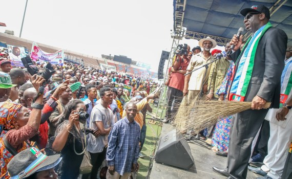 Governor Godwin Obaseki of Edo State (right) speaking at the APC Mega Rally held at the Samuel Ogbemudia Stadium in Benin City