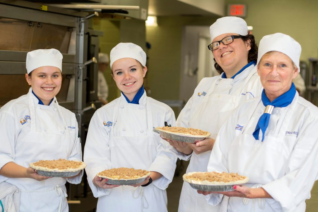 culinary students present pies