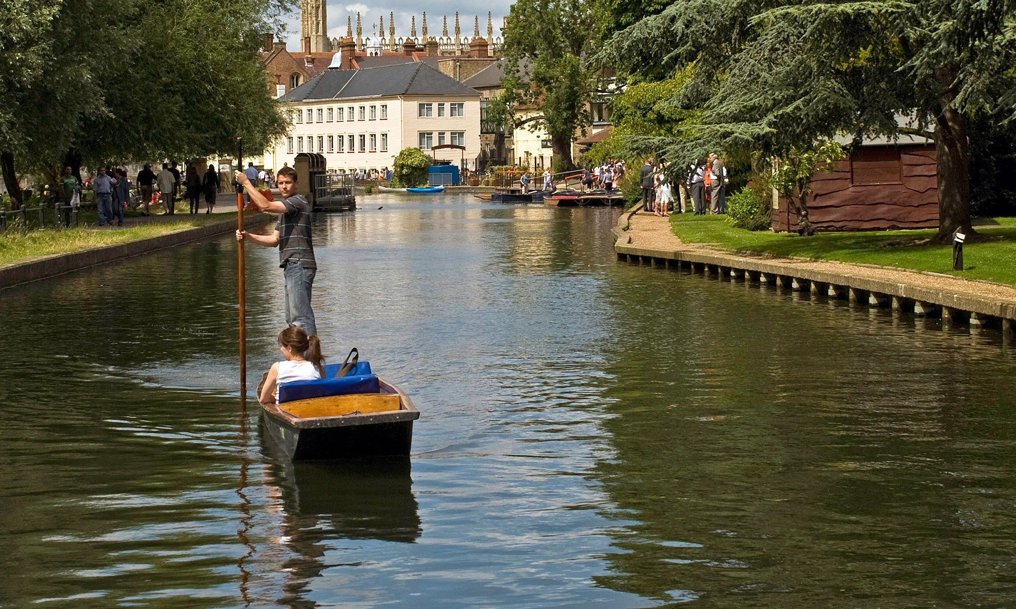 Couple Punting down River Cam in Cambridge