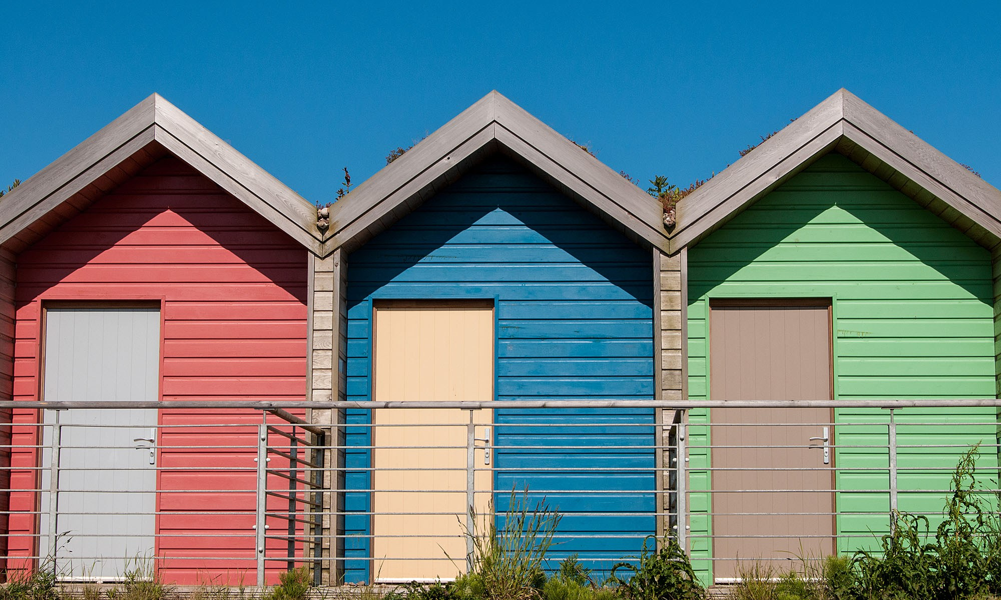 Red Blue and Green Beach Huts
