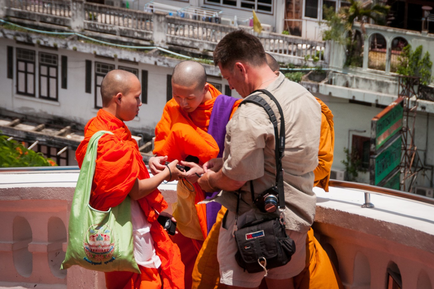 Buddhist Monks with Tourist