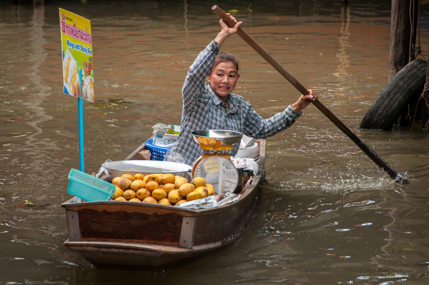 Market seller on a boat