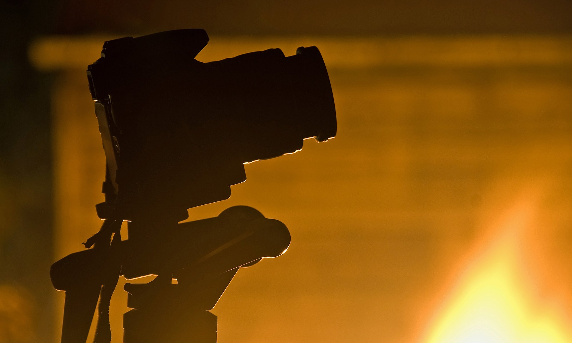 Camera Silhouette with Fire Background