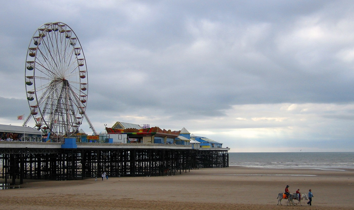 Blackpool's Central Pier with donkeys on beach