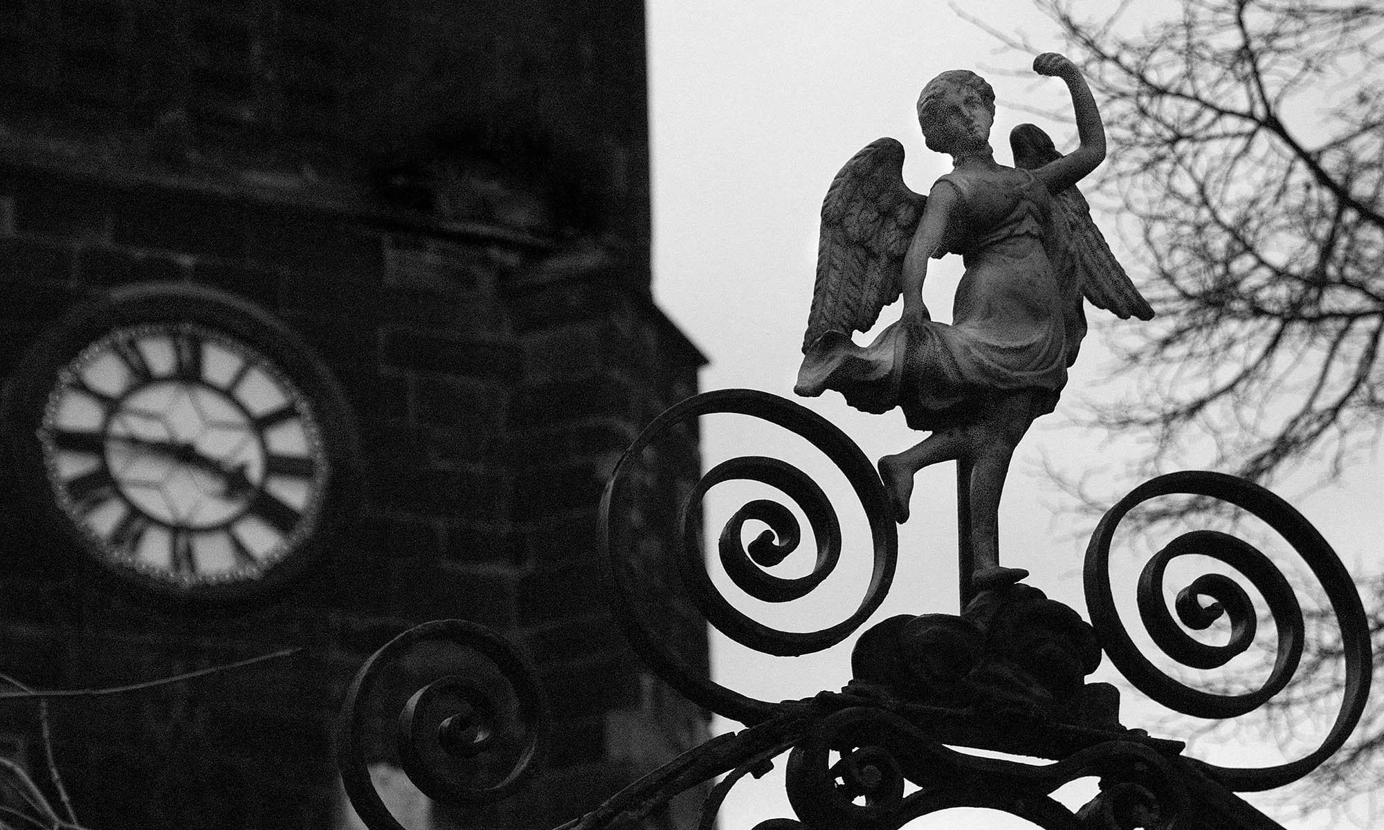 Church Clock and Statue detail