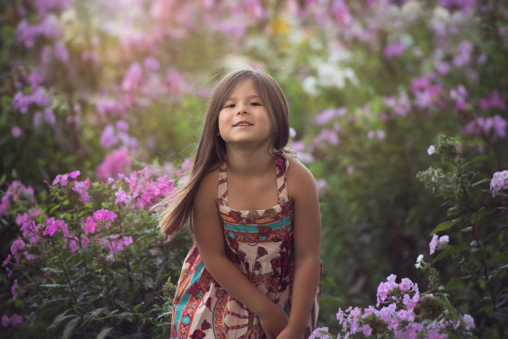 girl standing in flowers photo
