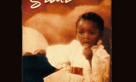 Simi Unveils Album Art for 'Omo Charlie Champagne' Vol. 1