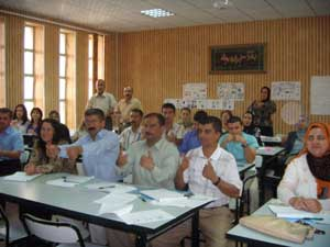 Deaf teachers demonstrating sign language and hearing teachers practising it