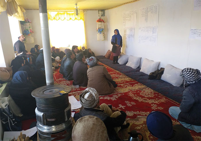 Young girl presents the children's plan for change, Ghazni, Afghanistan, 2019
