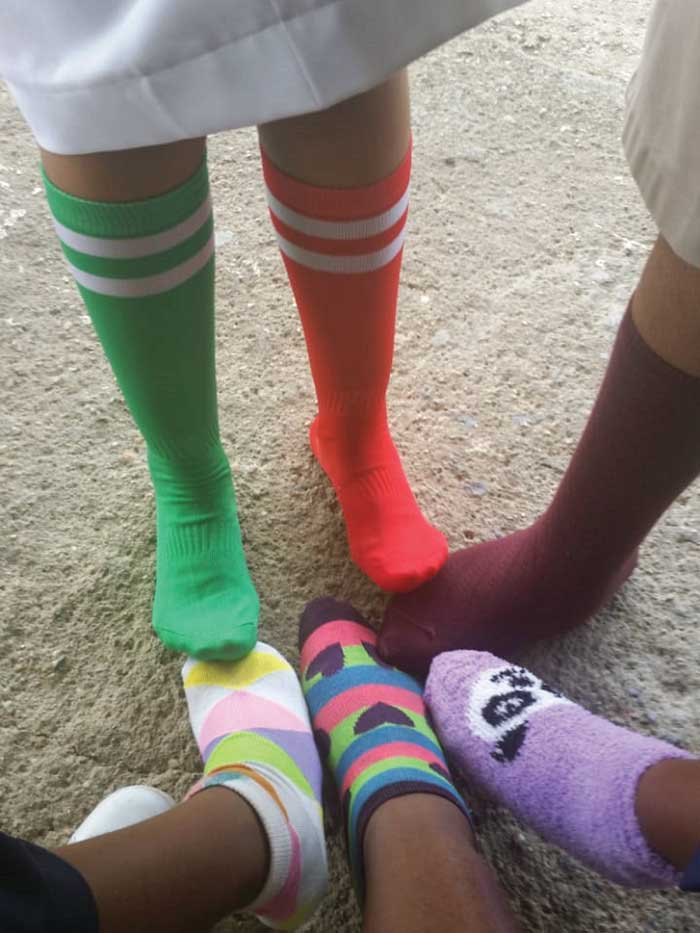 Wearing multi-coloured and mismatched socks for World Down Syndrome Day.