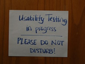 picture of handwritten sign on door reading 'Usability Testing in progress, PLEASE DO NOT DISTURB