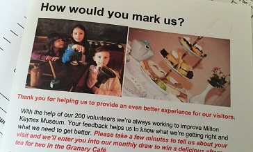 invitation to complete the visitor survey with a picture of afternoon tea and the message there is a monthly draw to win one