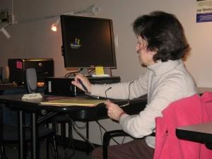 older woman sitting at computer